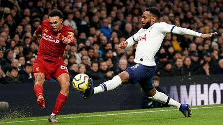 Liverpool's Trent Alexander-Arnold (left) and Tottenham Hotspur's Danny Rose battle for the ball (Pi