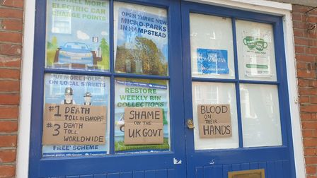 Placards seen stuck to the front of Hampstead and Kilburn Conservative Party's office on Sunday, Aug