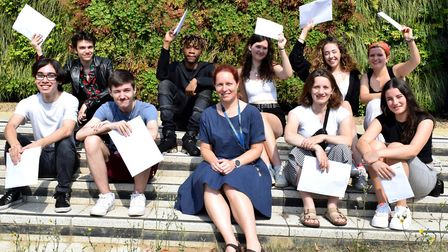 A group of students with A Level results at LaSwap in Camden, with William Ellis deputy headteacher