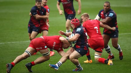 Saracens' Michael Rhodes tackles Bristol Bears' Harry Thacker during the Gallagher Premiership match