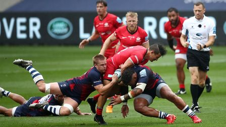 Bristol Bears' Dan Thomas (left) tackles Saracens' Juan Socino during the Gallagher Premiership matc