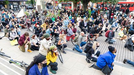 Protesters take the knee in solidarity with Sistah Space and the Black Lives Matter movement. Pictur