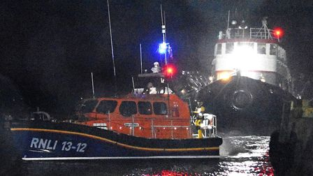 Lowestoft Lifeboat towing the tug and giant fenders back into harbour. Pictures: Mick Howes