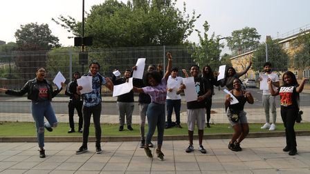 A Level results day 2020 at The Urswick School in Paragon Road. Students jump for joy - but at a soc