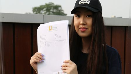 Anh Vu picks up her A Level results from The Urswick School.