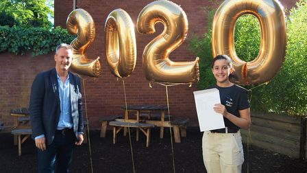 Head girl Soha picking up her results with NBH's executive headteacher Brendan Pavey. Picture: NBH H
