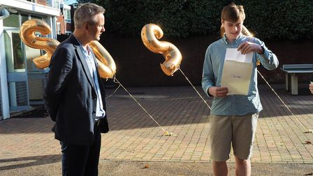 Edward Wright opening his grades with the executive headteacher, Brendan Pavey. Picture: NBH Hampste