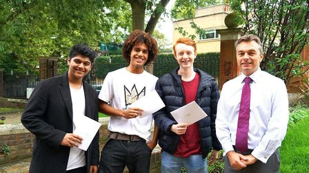 UCS Hampstead's headteacher, Mark Beard (far right), was 'delighted' for his students. Picture: UCS