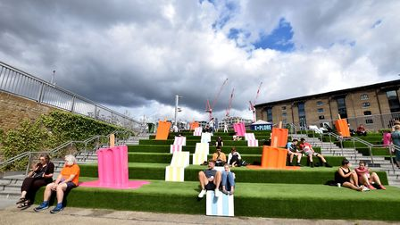 Relaxing on the canalside giant grass steps at Granary Square King's Cross. Picture: Polly Hancock