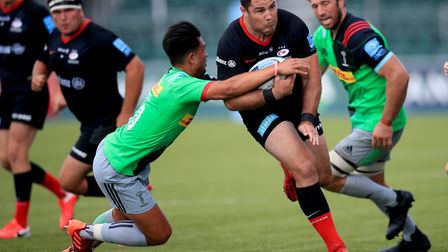 Saracens' Brad Barritt (second right) is tackled by Harlequins' Marcus Smith during the Gallagher Pr