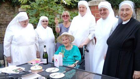 Angela Hutor, 107, with her daughter, Pauline, Mother Agnes in black and the nuns of St Annes Care H