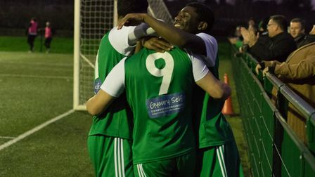 Hendon players mob Liam Brooks (pic DBeechPhotography)