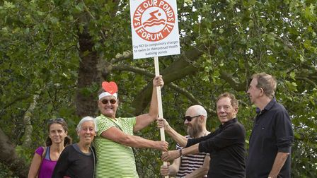Earl Johnson (centre) holds a placard at the Save Our Ponds demo on August 22. Picture: Josh Bratt