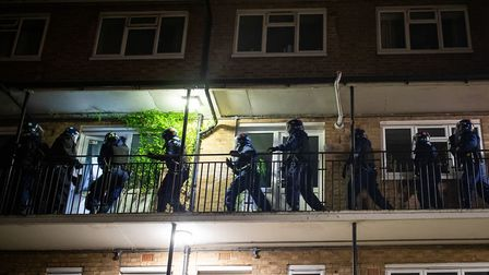 "Metropolitan Police officers raid a property on St Albans Road in London, as they target the ""elder"