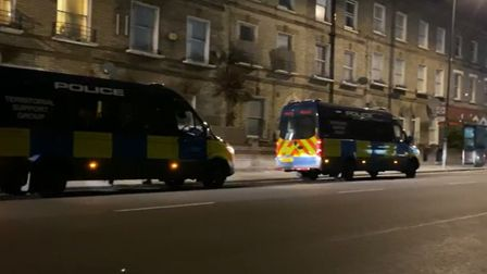 Police vans parked up during a dawn raid to target drug supply into Queen's Crescent. Picture: Met P