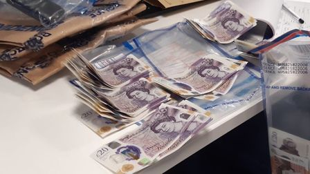 Cash seized in a series of police raids in Queen's Crescent. Picture: Met Police