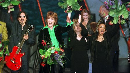 Katrina Leskanavich with her backing group the Waves celebrates her victory after winning the Eu