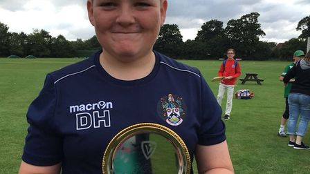 Lowestoft Town U13's successful team.Captain Dom Hailey with the carnival cup.Photos: Melanie Davey