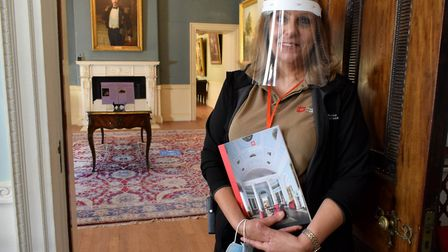 Maria Ioannou, a 'house explainer' at Kenwood House, at the door to Lord Mansfield's dressing room.
