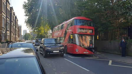 Traffic overtaking a stationary 168 bus in Fleet Road. Picture: Harry Taylor