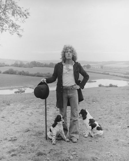 Singer Roger Daltrey in the countryside with his dogs on his estate in Sussex, 1978.