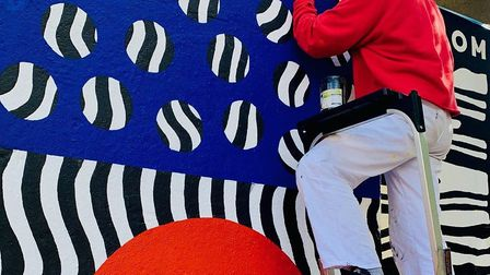 Artist Coco Lom took eight days to paint the mural in Newport School's playground in Leyton. Picture
