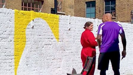 Coco Lom with Thierry Henry, an admirer of her 66-foot mural at Shoreditch Studios. Picture: Courtes