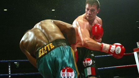 Enzo Maccarinelli (right) delivers a right hook to Bruce Scott during his win to claim the vacant WB