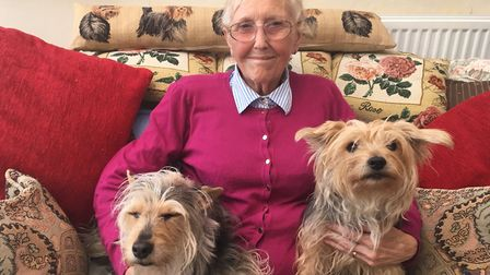 Diane Geraghty with her rescue dogs Buddy and Lucy. Photo: James Carr.