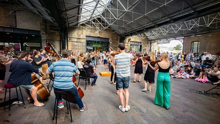 The Aurora Orchestra play outside at Kings Cross. Picture: Nick Rutter