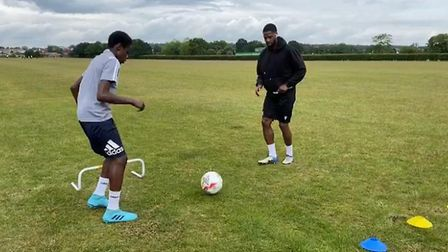 Ola Williams training one of the youngsters (Pic: Sporting Kids)