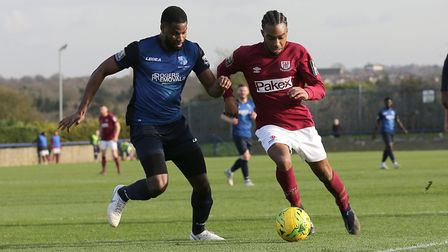 Dernell Wynter of Potters Bar and Ola Williams of Wingate & Finchley during Wingate & Finchley vs Po