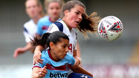 West Ham United's Kenza Dali (left) and Tottenham Hotspur's Siri Worm battle for the ball during the
