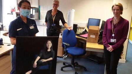 Vicky Pang was presented with her portrait by senior Royal Free staff. Picture: Royal Free