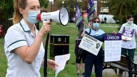 NHS occupational therapist Jordan Rivera speaks at a pay rise protest outside Homerton Hospital. Pic
