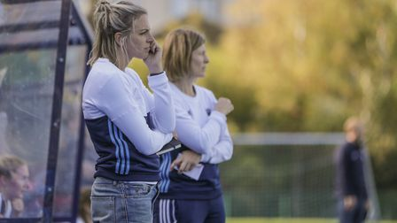 Kate Richardson-Walsh and Sarah Kelleher look on from the Hampstead & Westminster dugout (pic Mark C