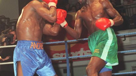 Former three-times world champion Dennis Andries covers up to avoid a right from Terry Dunstan, who