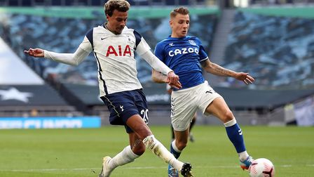 Tottenham Hotspur's Dele Alli and Everton's Lucas Digne (right) battle for the ball during the Premi