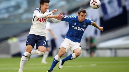 Tottenham Hotspur's Son Heung-min (left) and Everton's Seamus Coleman battle for the ball during the