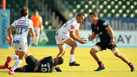 Exeter Chief's Phil Dollman is tackled by Saracens' Manu Vunipola (bottom) during the Gallagher Prem