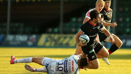 Saracens' Harry Sloan is tackled by Exeter Chief's Harvey Skinner (left) during the Gallagher Premie