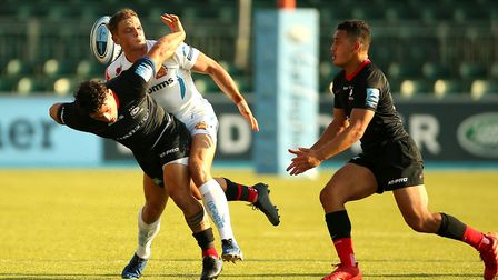 Saracens' Jun Pablo Socino (left) is tackled by Exeter Chief's Tom Wyatt during the Gallagher Premie