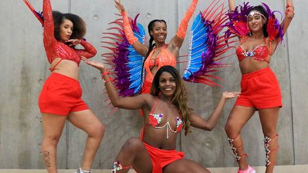 The quartet got dressed up in full carnival costume and performed work-outs for the community. Pictu