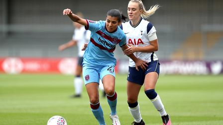 West Ham United's Kenza Dali (left) and Tottenham Hotspur's Josie Green battle for the ball during t