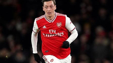 Charges of allegedly intimidating a security guard outside the house of Arsenal footballer and World