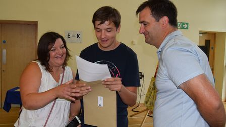 Greg Hurren opens his GSCE results at Pakefield High School. Picture: Mark Purvis