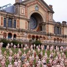 Two-hundred and twenty people posed nude, apart from white face masks, at London's Alexandra Palace