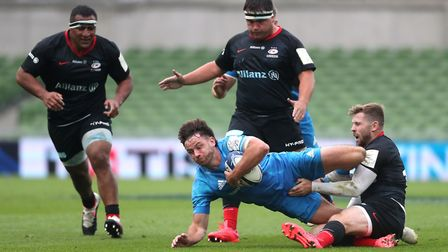 Leinster's Hugo Keenan is tackled by Saracens' Elliot Daly (right) during the European Champions Cup