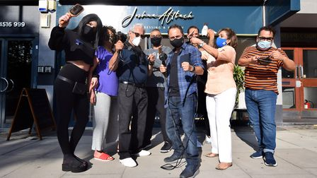 Joshua and Raymond Altback and their team of stylists outside their salon at 69 Fairfax Road NW6