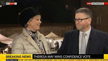 Anna Soubry and Robert Buckland exchange a smile after she says something under hear breath. Photogr